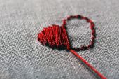 Canvas for embroidery and red sewing threads — Stock Photo