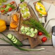 Still life with vegetarian sandwiches on wooden table — Stock Photo #75135623