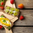 Still life with vegetarian sandwiches on wooden table — Stock Photo #75135643