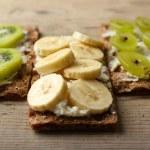 Tasty vegetarian sandwiches on wooden table — Stock Photo #75135659