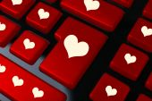 Close up of laptop keyboard with hearts icons — Stock Photo