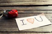 Written message with decorative heart — Stock Photo