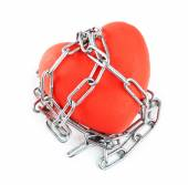 Red heart with metal chain isolated on white — Stock Photo