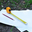 Building roulette and pencil on white sheets of paper, outdoors — Stock Photo #75300853