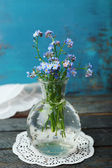 Composition with Forget-me-nots flowers on wooden background — Stock Photo