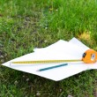 Building roulette and pencil on white sheets of paper, outdoors — Stock Photo #75430321