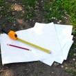 Building roulette and pencil on white sheets of paper, outdoors — Stock Photo #75430411