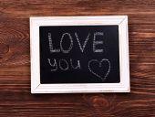 Inscription LOVE YOU on blackboard — Stock Photo