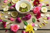 Cup of herbal tea with beautiful flowers, on wooden background — Stock Photo