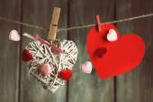 Bright hearts hanging on rope on wooden background — Stock Photo