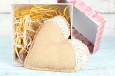 Vintage heart in present box on wooden table — Stock Photo