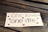 Written message on piece of paper on wooden table close up — Stock Photo