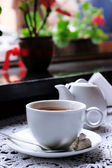 Hot chocolate in mug, on table, on bright background — Stock Photo
