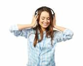Young woman with headphones isolated on white — Stock Photo