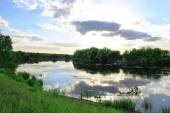 River bank over blue sky — Stock Photo