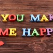 Inscription YOU MAKE ME HAPPY made of colorful letters — Стоковое фото #75532501