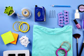 Modern female clothing and accessories on color background — Stock Photo