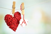 Hearts hanging on rope on bright background — Stock Photo