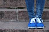Gumshoes on  stone stairs — Stock Photo