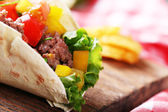 Homemade beef burrito with vegetables, potato chips — Stock Photo