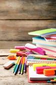 Bright school stationery on old wooden table — Stock Photo