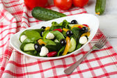 Fresh vegetable salad in bowl on table close up — Stock Photo