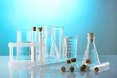 Empty laboratory test tubes  on blue background — Stock Photo