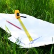 Building roulette and pencil on white sheets of paper, outdoors — Stock Photo #76108485