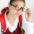 Beautiful little funny schoolgirl — Stock Photo #76111797