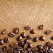 Frame of coffee beans on color sackcloth background — Stock Photo #76216157