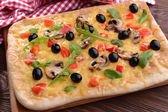 Delicious homemade pizza on table close-up — Stock Photo