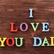 Inscription I LOVE YOU DAD made of colorful letters on wooden background — Stock Photo #76220533
