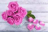 Beautiful pink roses on wooden background — Stock Photo