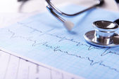 Cardiogram with stethoscope on table, closeup — Stock Photo
