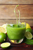 Glass of green healthy juice — Stock Photo