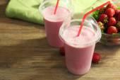 Milkshake with strawberries on table — Stock Photo