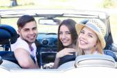 Young friends in cabriolet, outdoors — Stock Photo