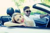 Young couple in cabriolet, outdoors — Stock Photo