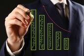 Zakenman hand schrijven van een business-grafiek — Stockfoto