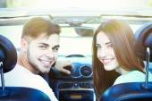Beautiful couple in cabriolet, outdoors — Stock Photo