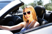Pretty girl in cabriolet, outdoors — Stock Photo