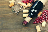 Glass bottle of wine with corks — Stock Photo