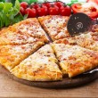 Cheese pizza on wooden cutting board, closeup — Stock Photo #76549773