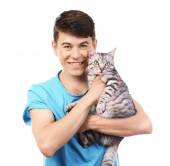 Handsome young man with cute cat isolated on white — Stock Photo