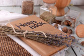 Dry lavender with nutmeg and book on table close up — Stock Photo
