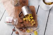 Dried herbs with nutmeg on table close up — Stock Photo