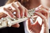 Musician playing flute, closeup — Stock Photo