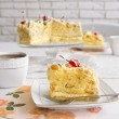 Peace of tasty Butter cake on plate, tea cups — Stock Photo #76818525