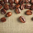 Frame of coffee beans on color sackcloth background — Stock Photo #76814089