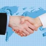 Business handshake on world map background — Stock Photo #77193337